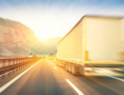 Generic Semi Trucks Speeding On The Highway At Sunset - Transpor